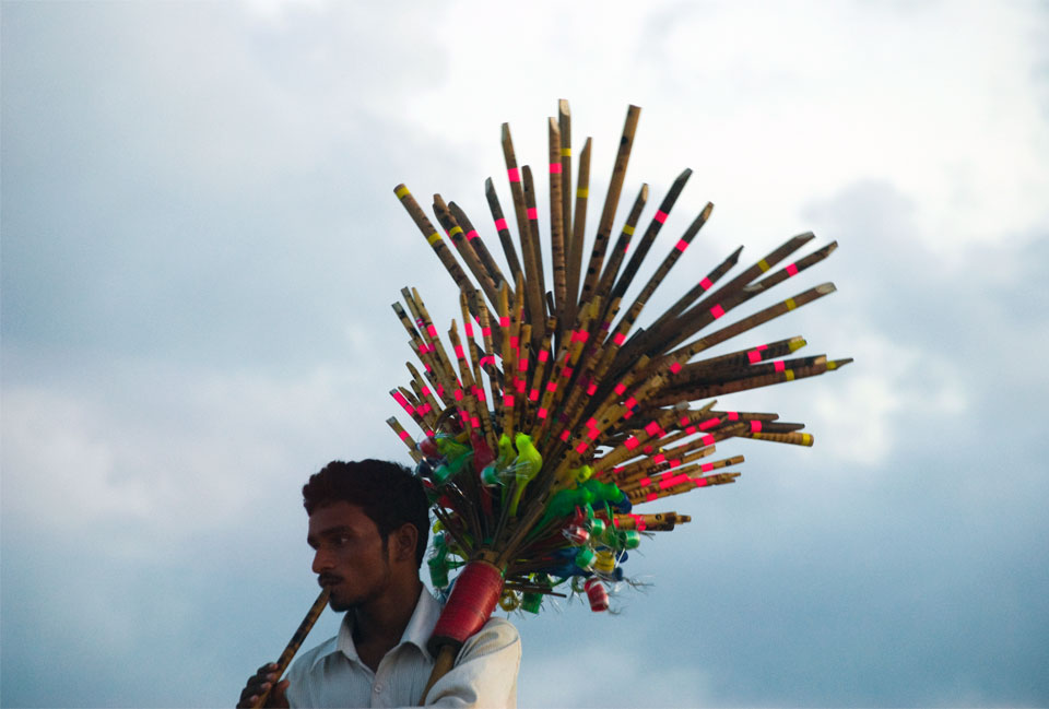 Picture of a flute vendor in India